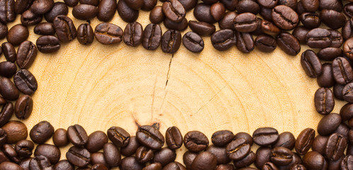 Coffee bean on wooden background.Gap in the middle