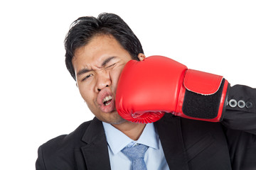 Asian businessman is  punched to his face