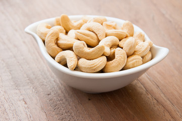 cashew nuts on white dish