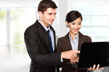 business partners using laptop at meeting
