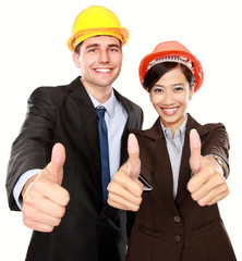 two standing workers showing thumbs up