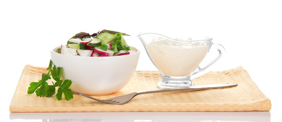 Bowl with salad, sour cream and fork