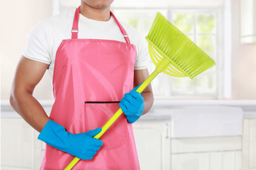 man's body with broom cleaning equipment