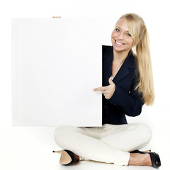 Woman with message board sitting on the floor