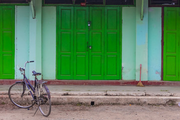 bicycle in front of geen door,Nyaung Shwe   in Myanmar (Burmar)