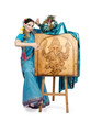 Artist posing next to easel with pyrography Lord Ganesha