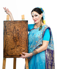 Artist standing with pyrography painting Eternal Harmony