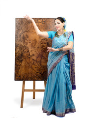 Artist in Indian sari posing with pyrography Lotus