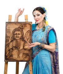 Artist showing pyrography painting Prosperity