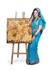 Woman in sari with painting Riot of the elements