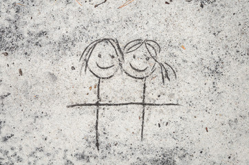 female couple drawing on sand background