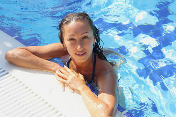 beautiful young girl in the pool