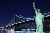 Manhattan Bridge and The Statue of Liberty at Night