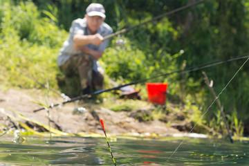 Man fishing at the edge of a lake