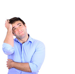 Portrait of young thoughtful businessman scratching head isolat