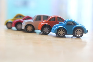 minature colorful cars standing in line showroom sale concept