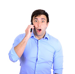 Shocked businessman talking on phone