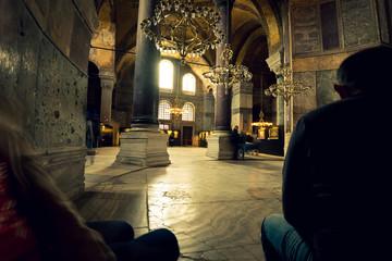 People sitting in Hagia Sophia