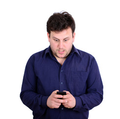 Shocked businessman looking at cell phone against white backgrou