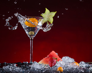 Fresh fruit cocktail in freeze motion splashing