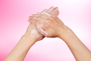 Woman's hands in soapsuds