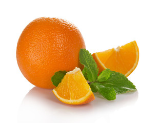 Big whole orange, slices and the mint