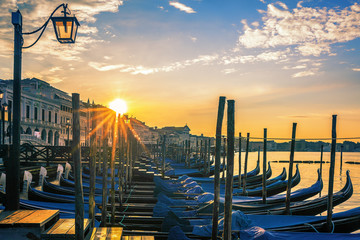 Venice with gondolas at sunrise