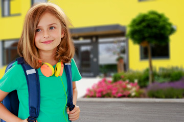 Back to school - portrait of beautiful young schoolgirl