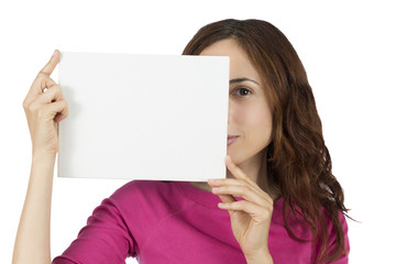 Young woman showing a blank billboard