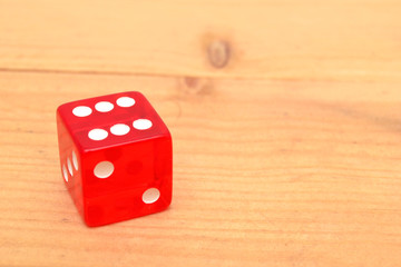 Red dice on wood