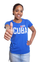 Woman from Cuba showing thumb up