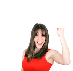 Excited happy success young woman with fists up isolated on whit