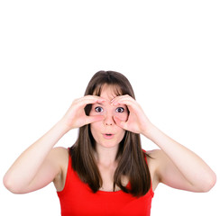 Portrait of young woman looking through imaginary binoculars iso