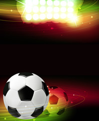 Spotlights and a soccer ball