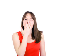 Portrait of young woman yawning isolated on white