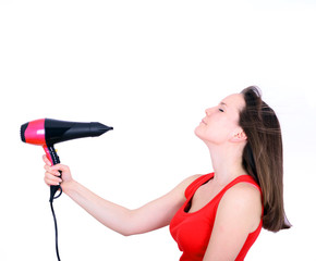 Woman with long hair holding strong blow dryer isolated on white