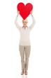 senior woman holding heart shape