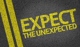 Expect the Unexpected written on the road poster