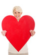 middle aged woman presenting heart shape