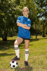 Attractive woman playing soccer