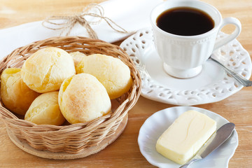 Brazilian snack cheese bread (pao de queijo) with cup of coffee