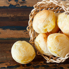 Brazilian snack cheese bread (pao de queijo) in wicker basket