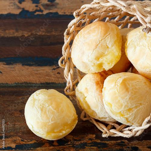 Fotobehang Brood Brazilian snack cheese bread (pao de queijo) in wicker basket