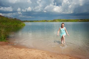 joyful girl on the lake