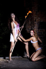 Two Amazon with torch in hand