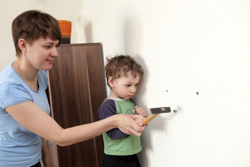 Mother and son with hammer