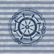 Nautical emblem with sea wheel