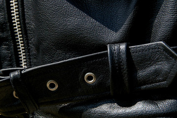 close up of black leather biker jacket belt