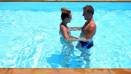 Young Couple Hugging in the Blue Outdoor Pool in Luxury Villa.