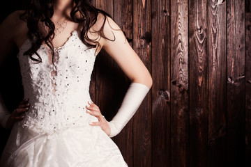 bride standing against wooden background